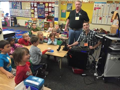 Peter demonstrating the 3D vision tracking algorithm at a local elementary school