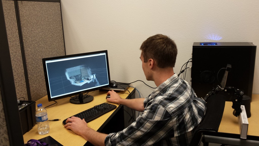 Peter Jeffris working on a 3D Vision system mounted on a Robai robot arm