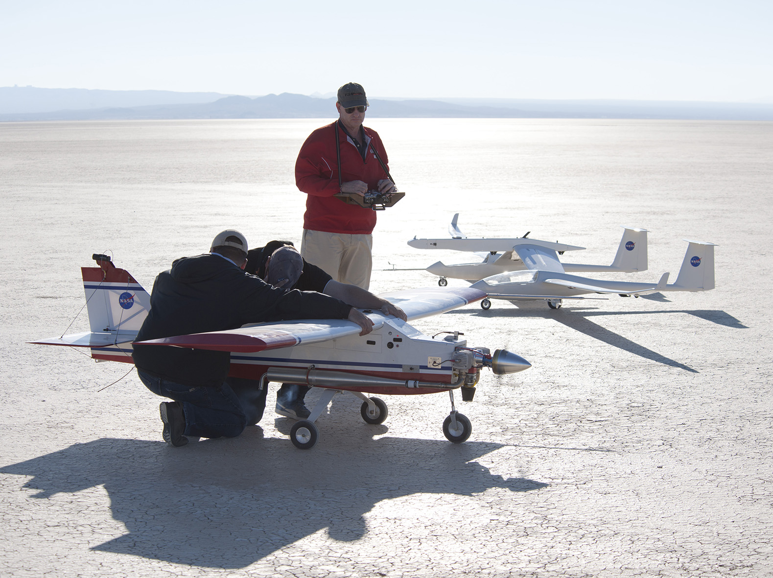 Towed Glider Air-Launch System and its Towing Plane on the Ground with Ground Crew for Sense of Scale